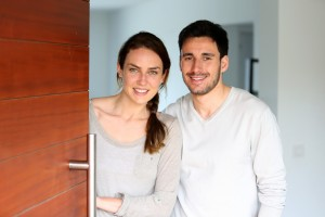 bigstock-Happy-couple-opening-new-home--64567864