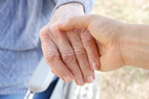 bigstock-Senior-woman-s-hand-and-helpin-15162029